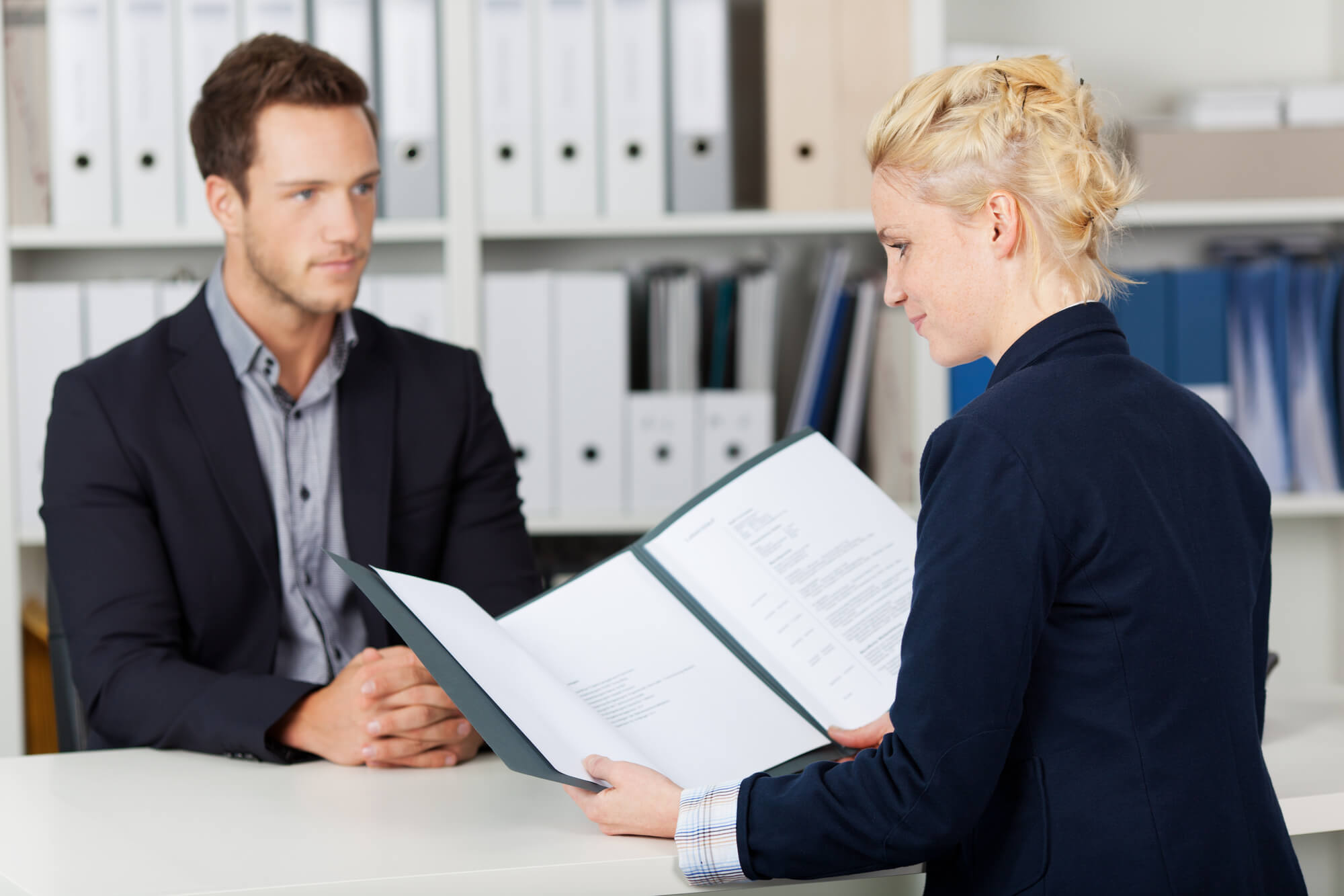 woman interviewing a man orthodontics positions hiring