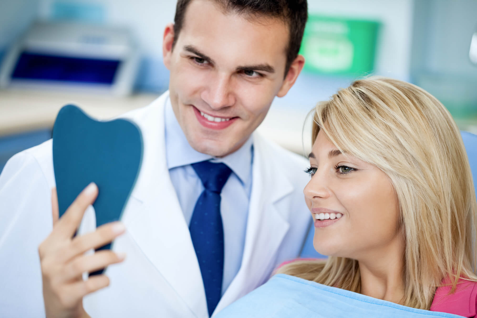 male dentist educating patient suitable for dentist positions hiring